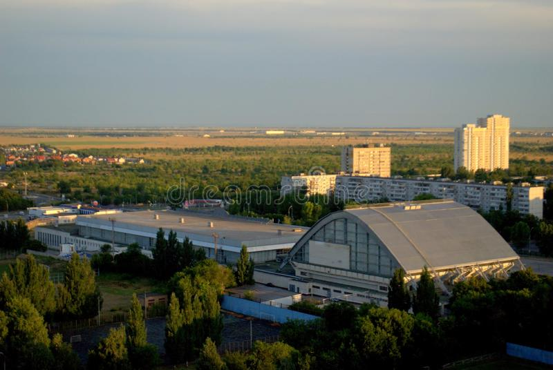 Morning view of the universal sports complex Olympus and new buildings on Sportivnaya street. stock photos