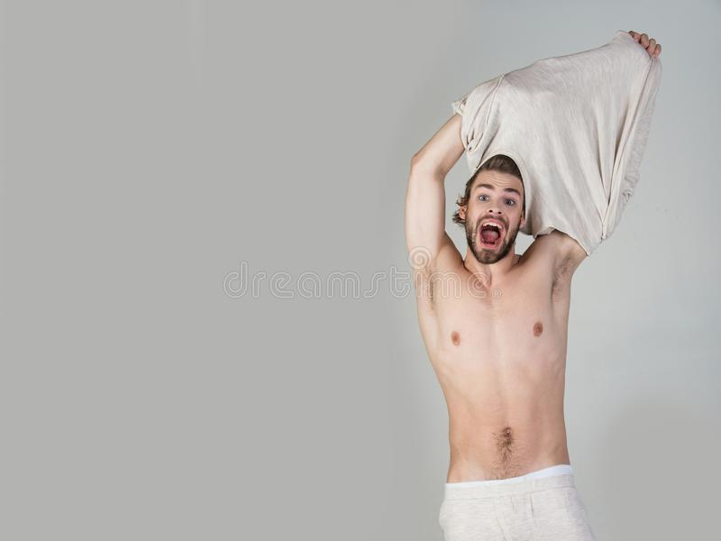 Morning wake up, everyday life. Barber and hairdresser, male fashion. Sleepy man undress on grey background. Insomnia, energy, single with uncombed hair. Man stock photos