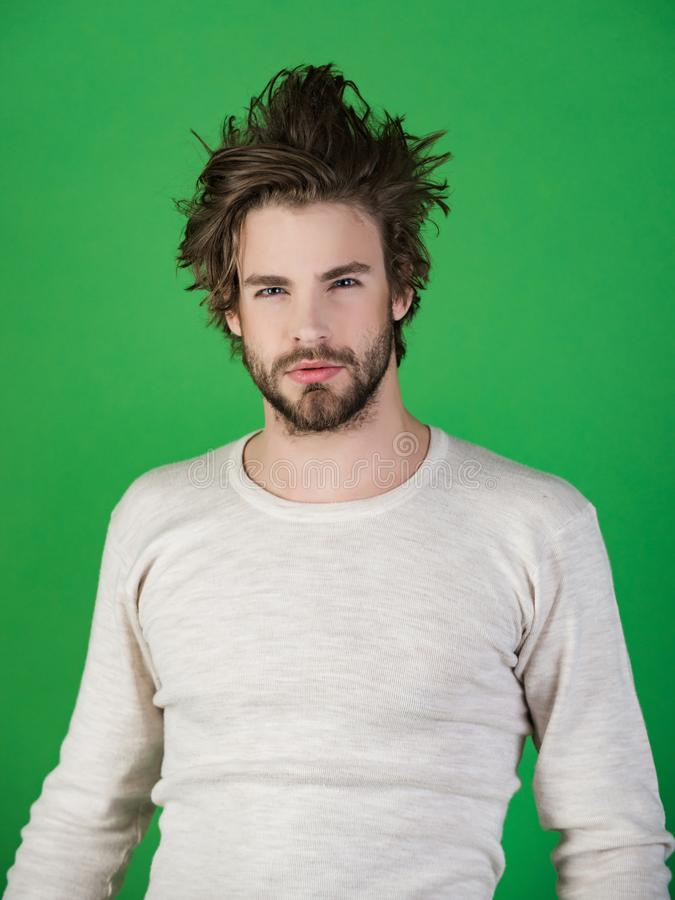 Morning wake up, everyday life. Man with disheveled hair in underwear. Insomnia, energy, single with uncombed hair. Sleepy man with beard on green background stock image