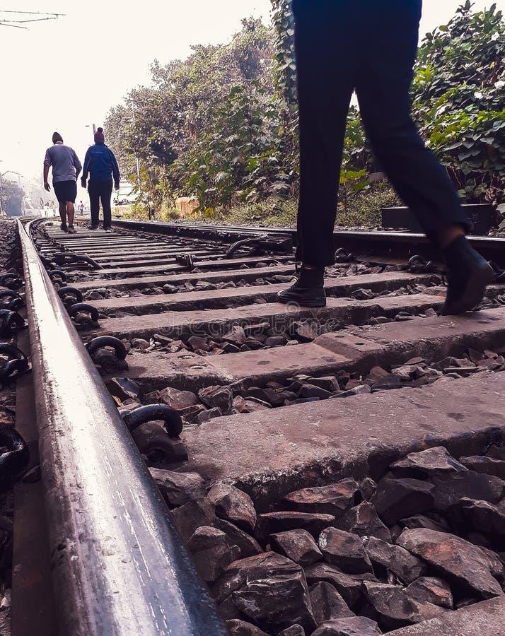 Morning walk along side of railway track stock photo
