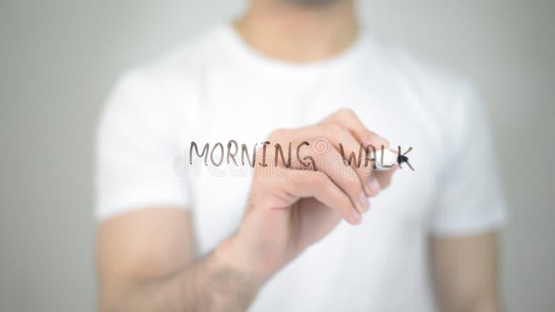 Morning Walk, man writing on transparent screen royalty free stock photos