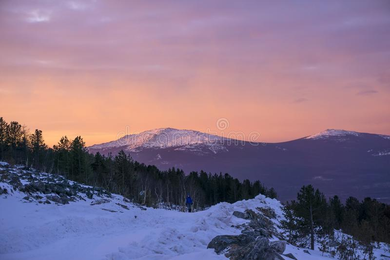 Morning walk in the winter mountains stock images