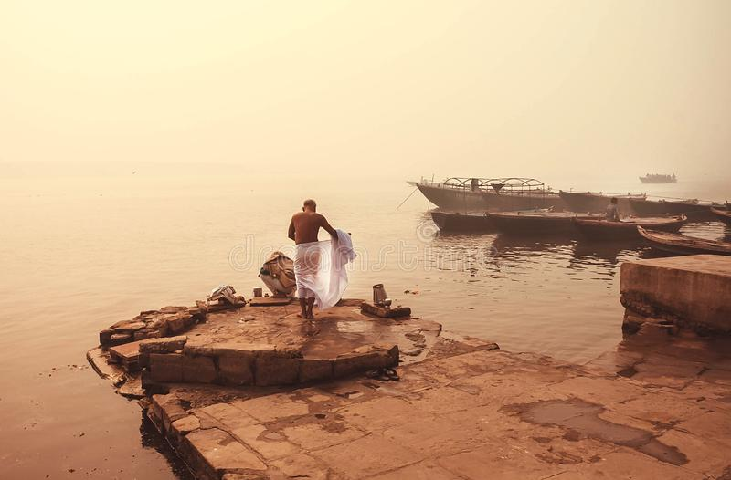 Morning washing in misty indian river Ganga, Varanasi. Calm meditative atmosphere with local people in India.  stock image