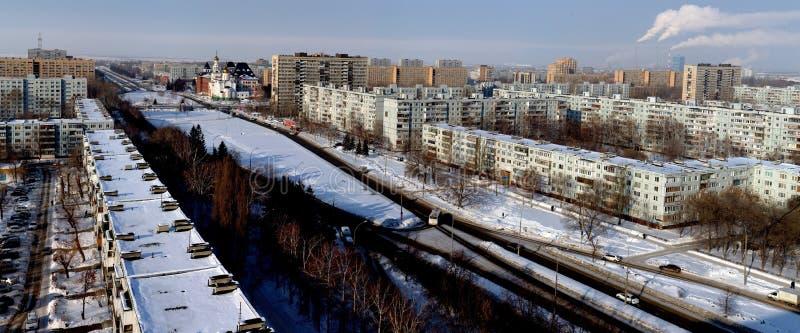 Morning winter panorama of the city of Togliatti overlooking the Sverdlov Street and the Volga Region Orthodox Institute. royalty free stock photo