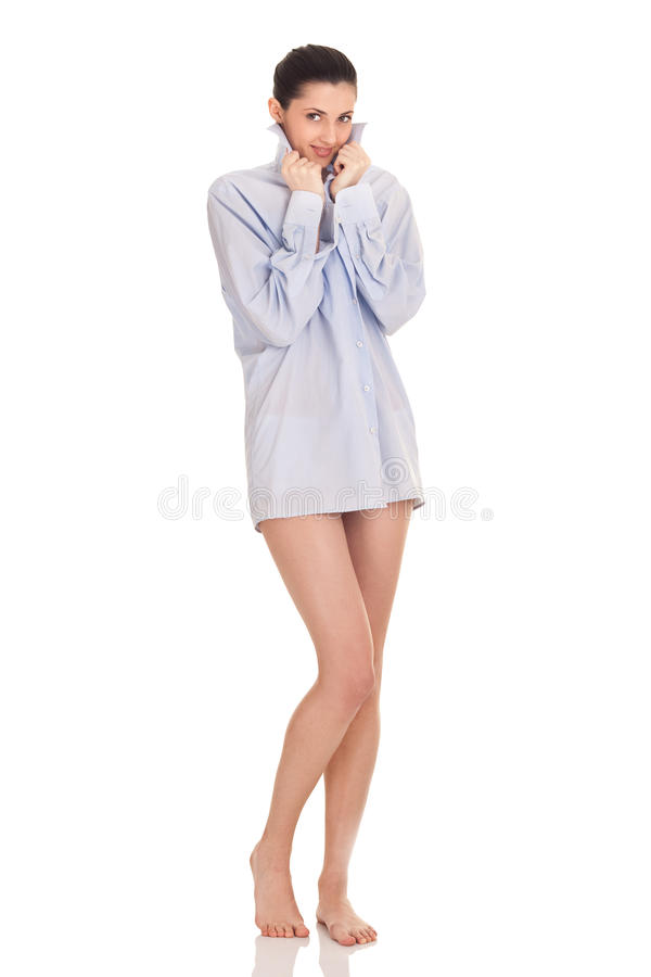 Morning, woman in man's shirt stock photo