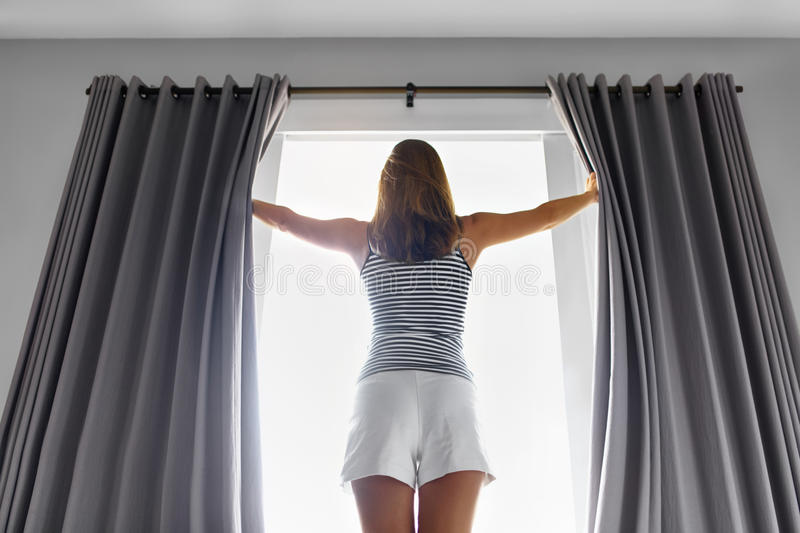 Morning. Woman Opening Curtains. New Day Concept. Wellness, Healthy. Morning. Beautiful Young Woman With Fit Slim Body Opening Curtains In Bedroom. Girl Standing royalty free stock photo