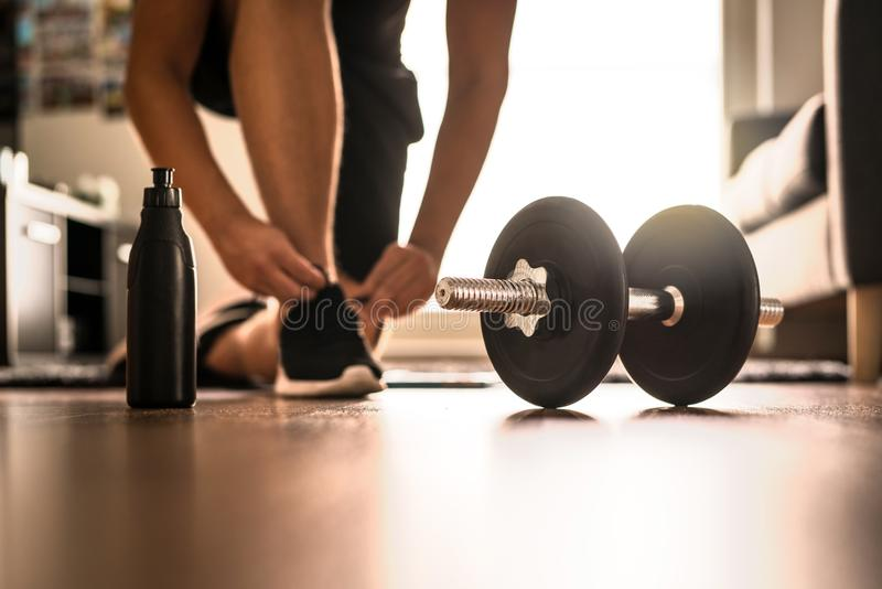 Morning workout routine in home gym stock photography