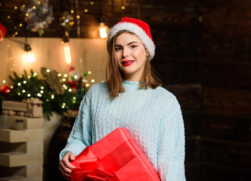 Morning before Xmas. Christmas tree. Winter holiday. Girl in santa claus hat. Christmas shopping. Happy new year. Family. Celebration. Sexy woman with present royalty free stock images