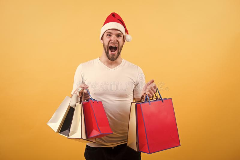 The morning before Xmas. delivery christmas gifts. man in santa hat hold christmas present. online christmas shopping. Happy new year. happy santa man on stock image