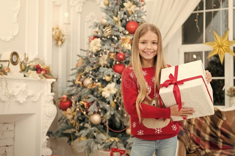 The morning before Xmas. Little girl. Happy new year. Winter. xmas online shopping. Family holiday. Christmas tree and. Presents. Child enjoy the holiday. Best stock image