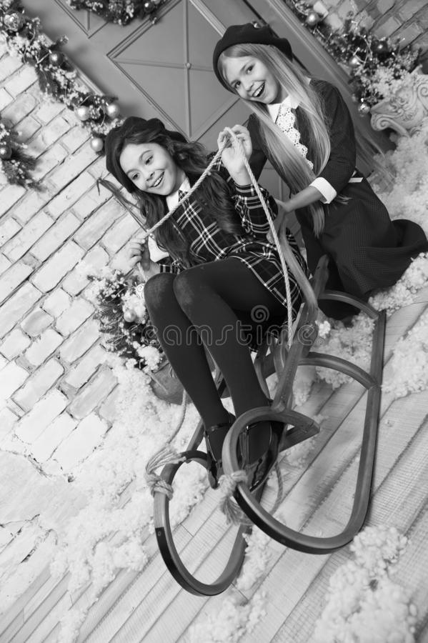 The morning before Xmas. Little girls on sleigh. Happy new year. Winter. xmas online shopping. Family holiday. Christmas. Tree and presents. Child enjoy the royalty free stock photography