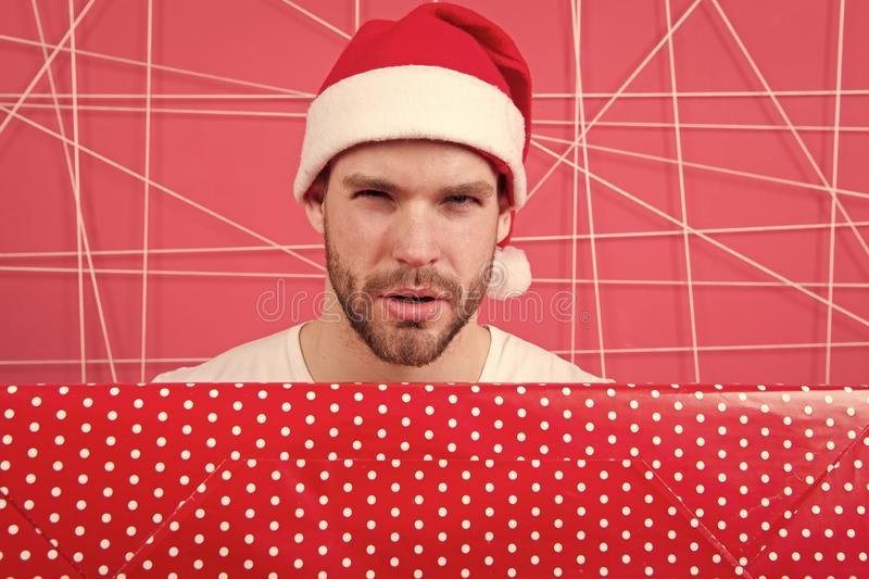The morning before Xmas. man enjoy the holiday. man in santa hat hold christmas present. delivery christmas gifts. Are. You ready. New year new goals. Capturing royalty free stock photo