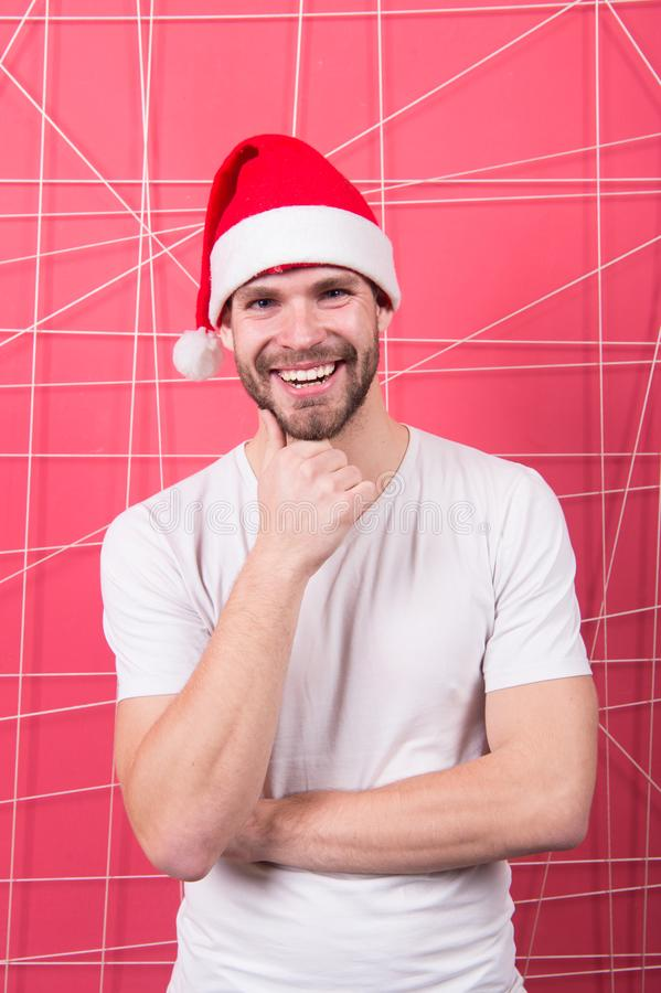 The morning before Xmas. man in santa hat hold christmas present. happy santa man. online christmas shopping. Happy new stock image