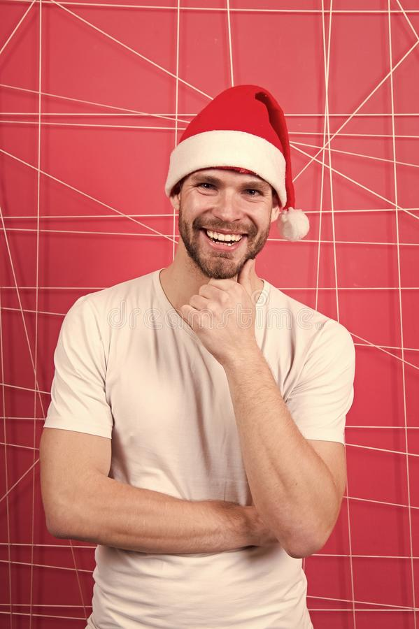 The morning before Xmas. man in santa hat hold christmas present. happy santa man. online christmas shopping. Happy new. Year. delivery christmas gifts. Winter royalty free stock photography