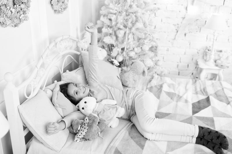 Morning before Xmas. sleeping and dreaming. Cute little child girl with xmas present. happy little girl celebrate winter royalty free stock photos
