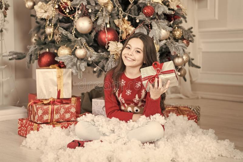 The morning before Xmas. waiting for santa. Xmas. christmas family holiday. happy new year. Christmas shopping. Cute. Little child girl with xmas present. New royalty free stock photos