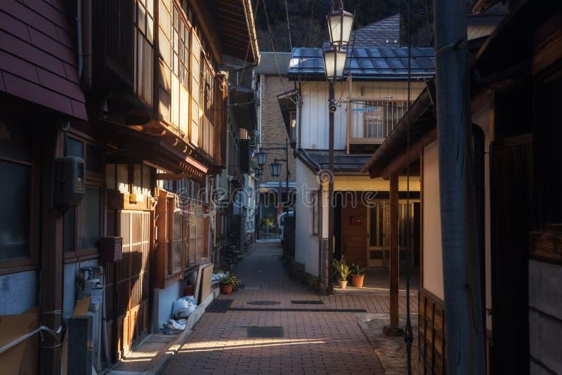 Morning at Yamanouchi onsen city, Nagano. Small village alleys with light shade in the morning at Yamanouchi city, Nagano, Japan. Here is famous of having hot royalty free stock photo