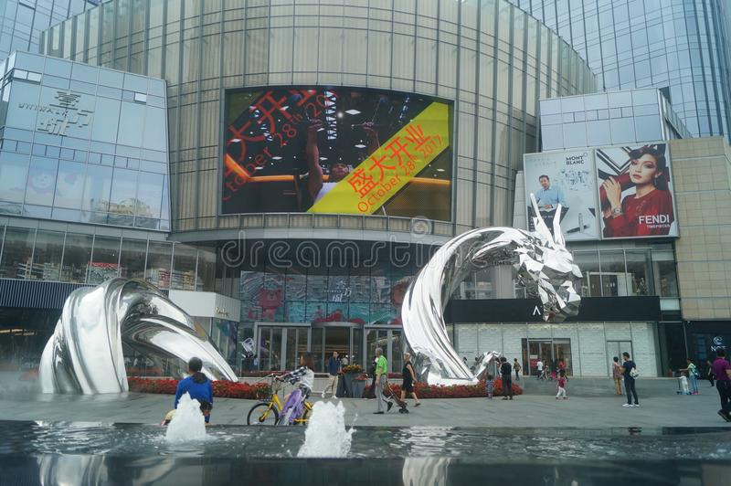 Shenzhen, China: adults and children play around the fountain in the shopping mall. In the morning, Yi Fang Cheng shopping mall fountain pool, adults and royalty free stock photography