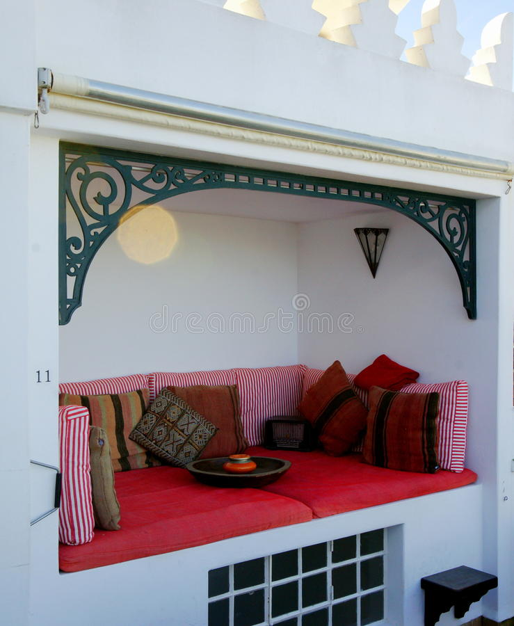 Moroccan Alcove. A cozy alcove on the rooftop of a house in the old part of Tangier, Morocco royalty free stock image