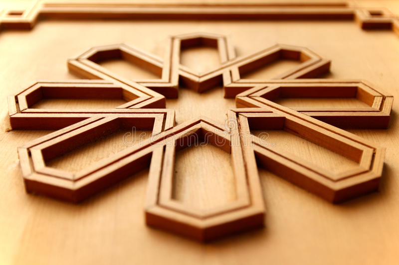 Moroccan arabesque carved wood panel. With geometrical pattern on a door in Fes, Morocco royalty free stock image