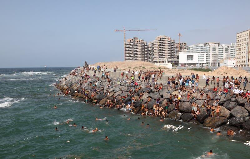 Moroccan boys swim in the sea stock photos