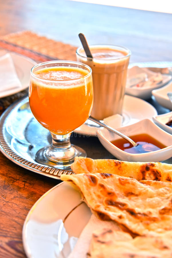 Moroccan breakfast served on hotel terace in Atlas Mountains royalty free stock photos