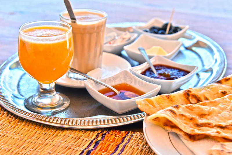 Moroccan breakfast served on hotel terace in Atlas Mountains stock images
