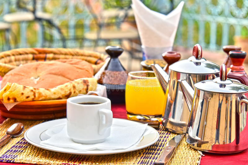 Moroccan breakfast served on hotel terace in Atlas Mountains royalty free stock photo