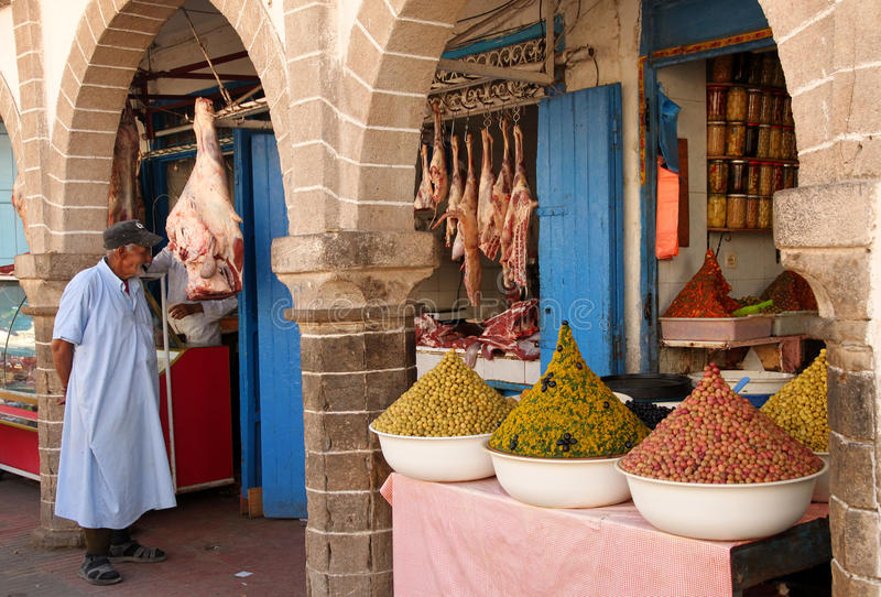 Moroccan butcher and olive seller royalty free stock photo
