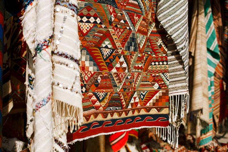 Moroccan Carpets in a street shop souk stock photos