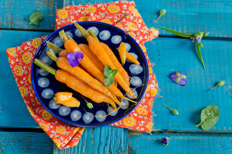 Moroccan carrot. In blue plate on bright colored wooden background stock photo