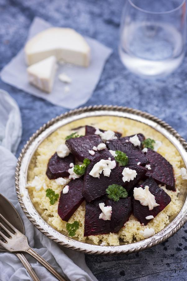 Moroccan couscous salad with Beetroot stock photo