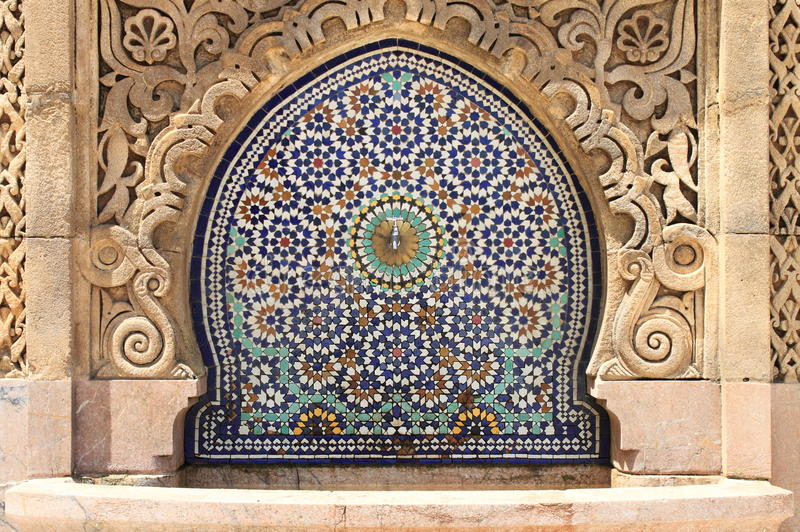 Moroccan fountain with mosaic tiles stock image