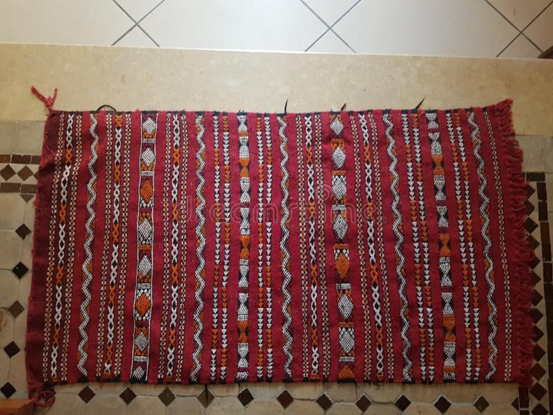 Moroccan handmade carpet. Vintage traditional fabric red patern floor art amazigh stock photos