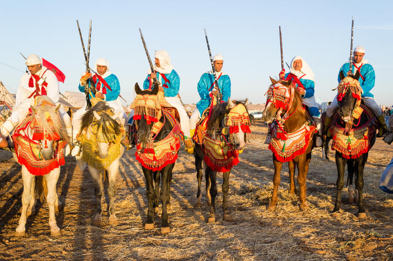 Moroccan horse riders during fantasia festival stock images