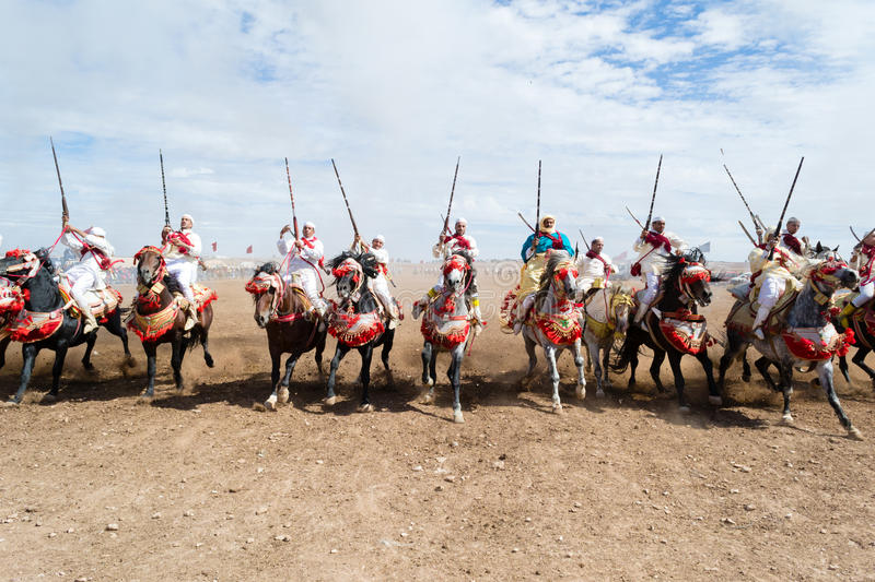 Moroccan horse riders in Fantasia performance royalty free stock image