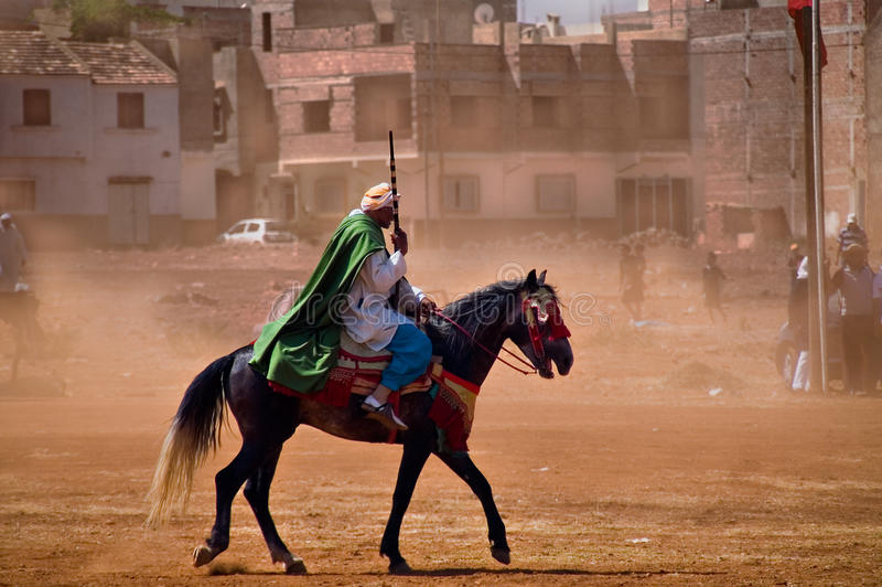Moroccan horseman with gun royalty free stock photo