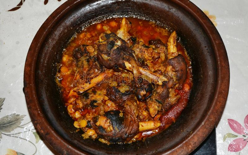 Moroccan Lamb Trotters Tajine With Raisins And Chickpeas stock image
