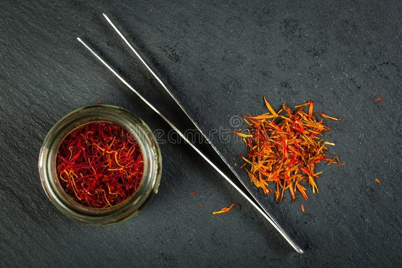 Moroccan left and Turkish right saffron royalty free stock photo