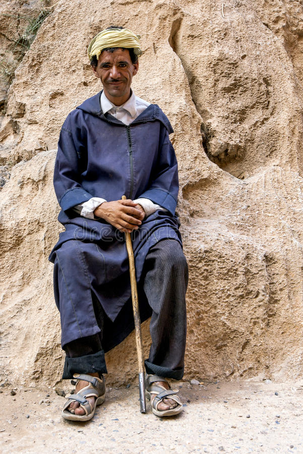 A Moroccan man poses for a photograph at Todra Gorge, Morocco. royalty free stock image