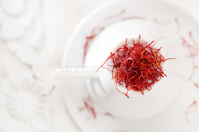 Moroccan saffron treads in pile, on white stock images