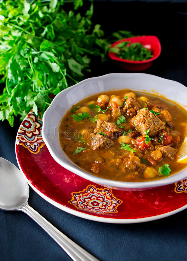Moroccan soup harira with meat, chickpeas, lentil, tomato and sp. Ices. Hearty, fragrant. Preparing for Iftar in the holy month of Ramadan royalty free stock image