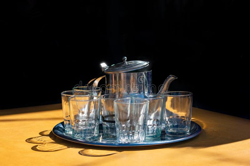 Moroccan Tea Set with Glasses in front of a Black Background stock photos