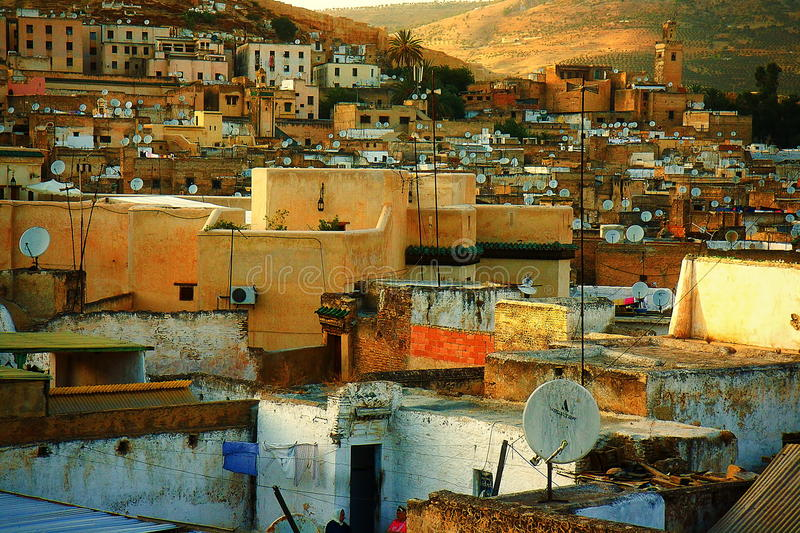 Moroccan town in sunlight. Satellites on the roofs of an ancient city of Fes.  stock photo