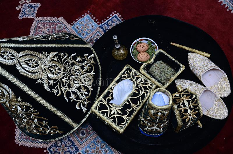Moroccan Tyafer, traditional gift containers for the wedding ceremony, decorated with ornate golden embroidery.Moroccan henna .wed stock images