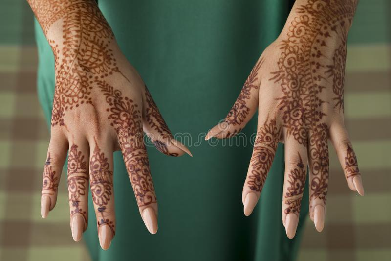 Moroccan woman with henna painted hands stock photography