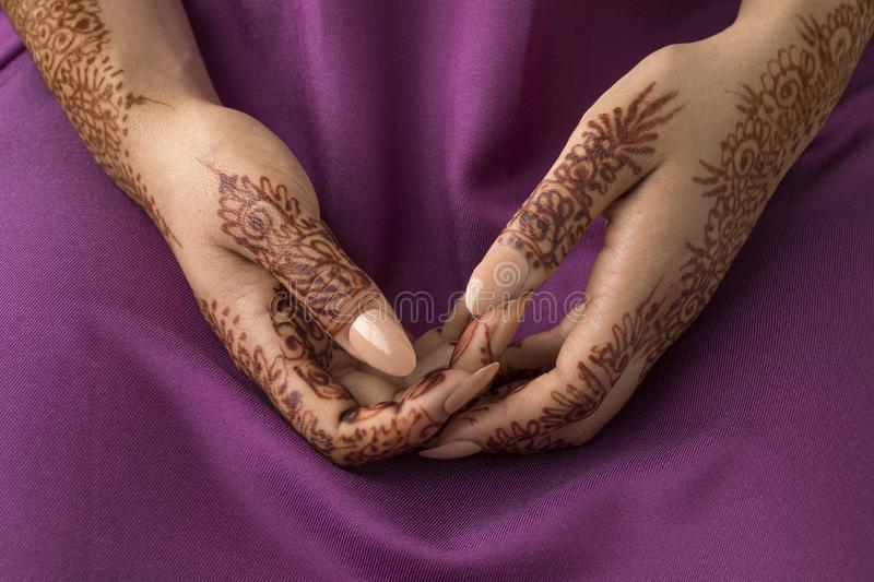 Moroccan woman with henna painted hands royalty free stock photography