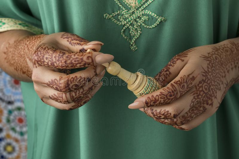 Moroccan woman with henna painted hands stock image