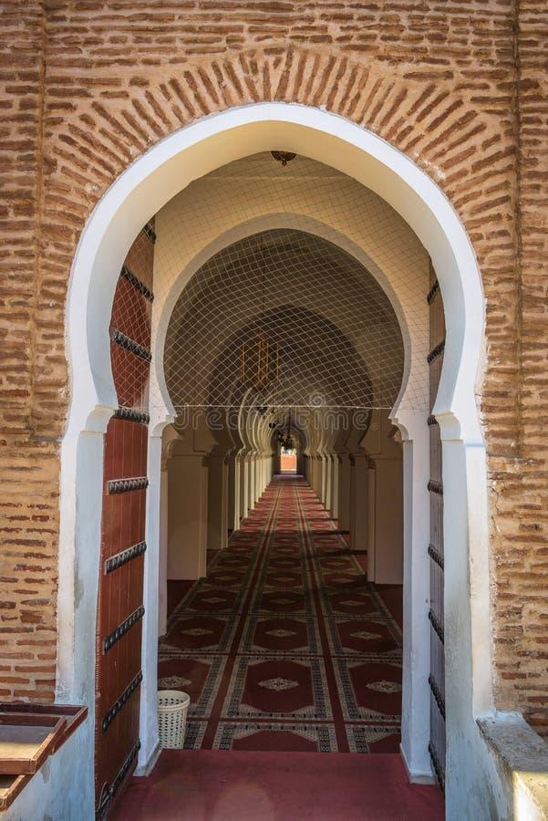 Moroccan wooden door leading into an islamic mosque in Marrakech, Morocco royalty free stock photos