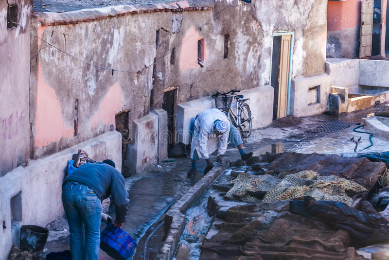 Moroccan workers dyeing fabrics royalty free stock images
